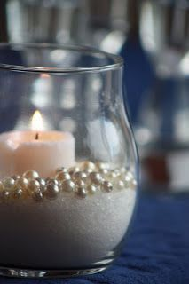 Sand, candle, pearls