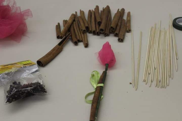 Besamim rose. Cinnamon stick and tule with cloves inside