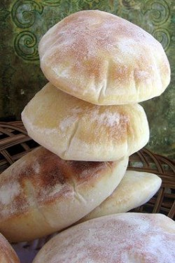 Easy pita recipe:   Baking & Spices  3 cups Flour  1 tsp Salt  1 tbsp Yeast   Liquids  1 1/4 ...