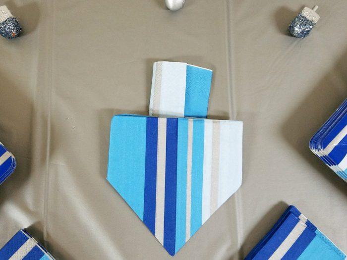 https://www.momsandcrafters.com/dreidel-napkin-fold/  dreidel napkin fold